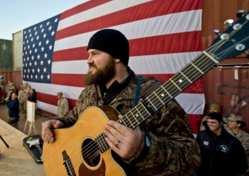 Entertainers on the USO Tour perform and greet the troops.