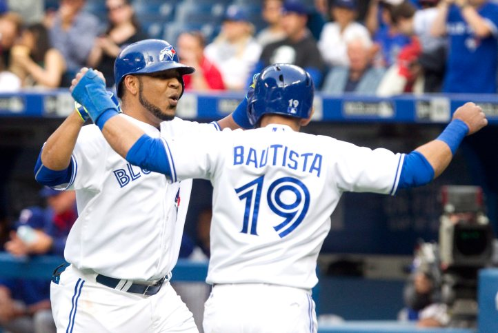 Toronto Blue Jays' Edwin Encarnacion is greeted by teammate Jose Bautista at home plate after Encarnacion hit a grand slam in the first inning of their AL baseball game against the Texas Rangers in Toronto Friday June 26, 2015. THE CANADIAN PRESS/Fred Thornhill